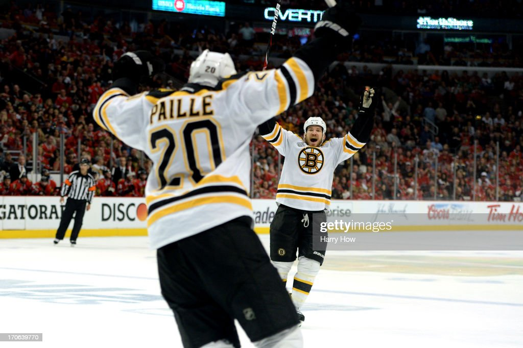 <a gi-track='captionPersonalityLinkClicked' href=/galleries/search?phrase=Daniel+Paille&family=editorial&specificpeople=706561 ng-click='$event.stopPropagation()'>Daniel Paille</a> #20 and <a gi-track='captionPersonalityLinkClicked' href=/galleries/search?phrase=Andrew+Ference&family=editorial&specificpeople=202264 ng-click='$event.stopPropagation()'>Andrew Ference</a> #21 of the Boston Bruins celebrate after Paille scored the game-winning goal in the first overtime against the Boston Bruins in Game Two of the NHL 2013 Stanley Cup Final at United Center on June 15, 2013 in Chicago, Illinois.