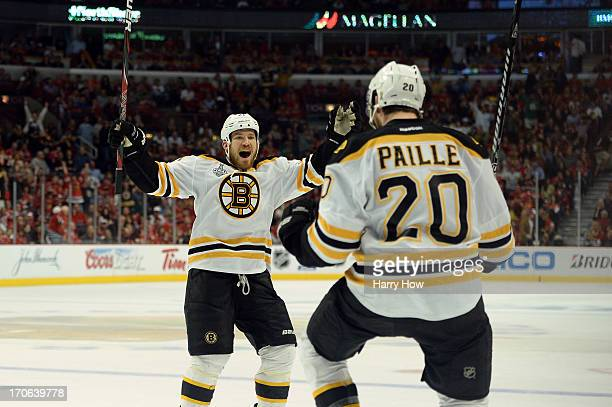 Daniel Paille and Andrew Ference of the Boston Bruins celebrate after Paille scored the gamewinning goal in the first overtime against the Boston...