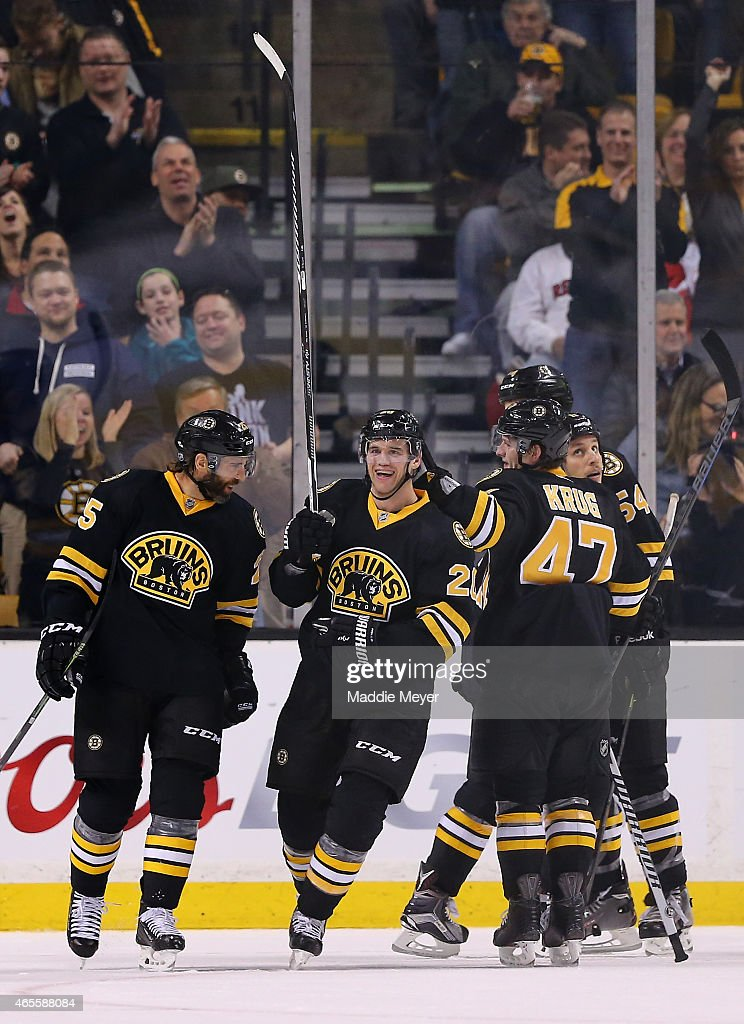 Daniel Paille #20 is congratulated by Maxime Talbot #25 and Torey Krug #47 of the Boston Bruins after he scored a goal against the Detroit Red Wings in the second period at TD Garden on March 8, 2015 in Boston, Massachusetts.