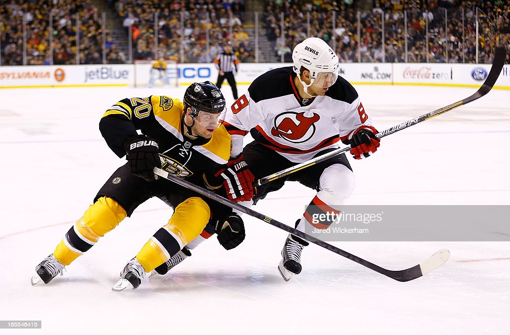 <a gi-track='captionPersonalityLinkClicked' href=/galleries/search?phrase=Daniel+Paille&family=editorial&specificpeople=706561 ng-click='$event.stopPropagation()'>Daniel Paille</a> #20 of the Boston Bruins and <a gi-track='captionPersonalityLinkClicked' href=/galleries/search?phrase=Dainius+Zubrus&family=editorial&specificpeople=204779 ng-click='$event.stopPropagation()'>Dainius Zubrus</a> #8 of the New Jersey Devils skate to the puck in the corner during the game on April 2, 2013 at TD Garden in Boston, Massachusetts.