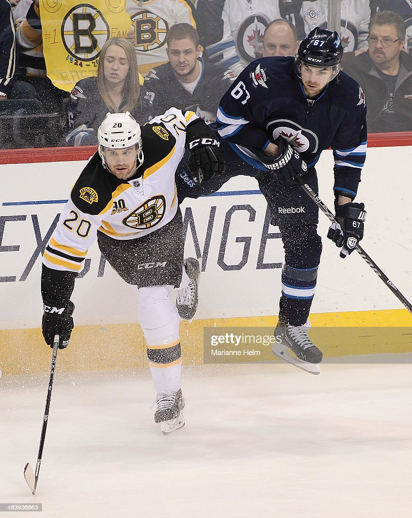 <a gi-track='captionPersonalityLinkClicked' href=/galleries/search?phrase=Daniel+Paille&family=editorial&specificpeople=706561 ng-click='$event.stopPropagation()'>Daniel Paille</a> #20 of the Boston Bruins and <a gi-track='captionPersonalityLinkClicked' href=/galleries/search?phrase=Michael+Frolik&family=editorial&specificpeople=537965 ng-click='$event.stopPropagation()'>Michael Frolik</a> #67 of the Winnipeg Jets collide in third-period action in an NHL game at the MTS Centre on April 10, 2014 in Winnipeg, Manitoba, Canada.