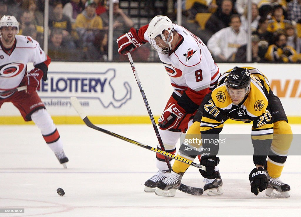 <a gi-track='captionPersonalityLinkClicked' href=/galleries/search?phrase=Daniel+Paille&family=editorial&specificpeople=706561 ng-click='$event.stopPropagation()'>Daniel Paille</a> #20 of the Boston Bruins battles for the puck against <a gi-track='captionPersonalityLinkClicked' href=/galleries/search?phrase=Jaroslav+Spacek&family=editorial&specificpeople=204681 ng-click='$event.stopPropagation()'>Jaroslav Spacek</a> #8 of the Carolina Hurricanes at TD Garden on February 2, 2012 in Boston, Massachusetts. The Hurricanes defeated the Bruins 3-0.