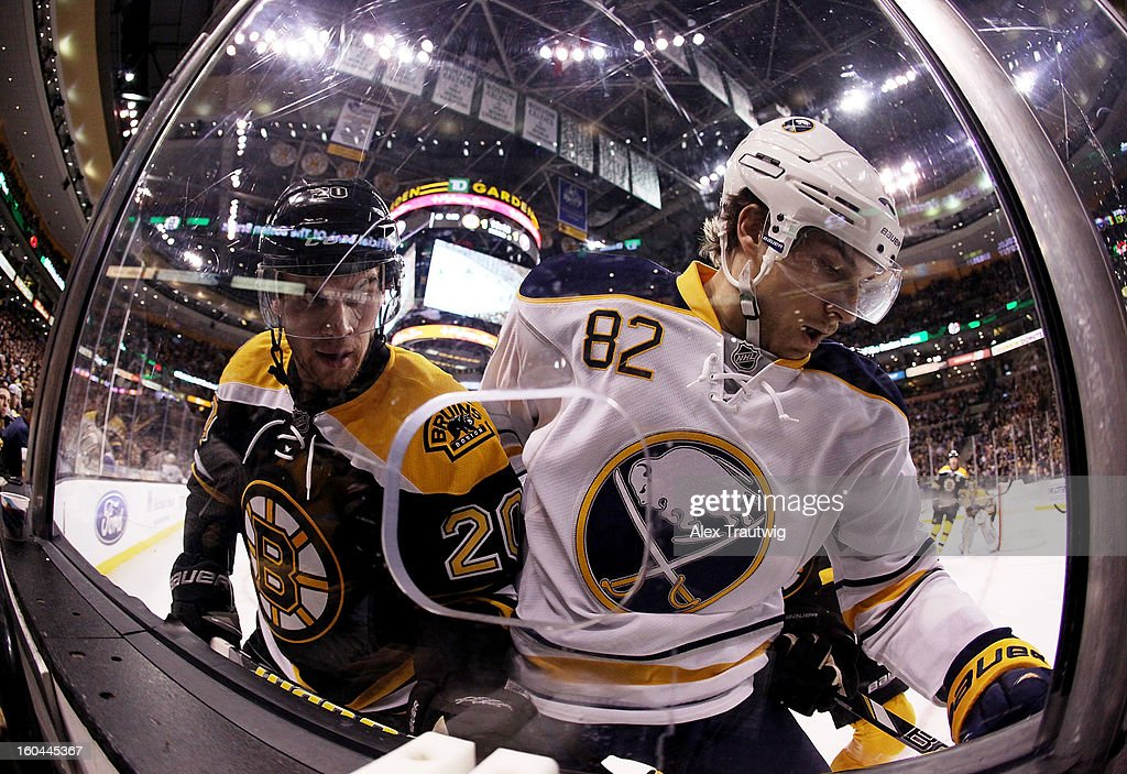 <a gi-track='captionPersonalityLinkClicked' href=/galleries/search?phrase=Daniel+Paille&family=editorial&specificpeople=706561 ng-click='$event.stopPropagation()'>Daniel Paille</a> #20 of the Boston Bruins battles for the puck against Marcus Foligno #82 of the Buffalo Sabres during a game at the TD Garden on January 31, 2013 in Boston, Massachusetts. The Sabres defeated the Bruins 7-4.