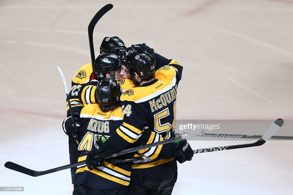 <a gi-track='captionPersonalityLinkClicked' href=/galleries/search?phrase=Daniel+Paille&family=editorial&specificpeople=706561 ng-click='$event.stopPropagation()'>Daniel Paille</a> #20 of the Boston Bruins celebrates with Chris Kelly #23, <a gi-track='captionPersonalityLinkClicked' href=/galleries/search?phrase=Torey+Krug&family=editorial&specificpeople=6670036 ng-click='$event.stopPropagation()'>Torey Krug</a> #47 and <a gi-track='captionPersonalityLinkClicked' href=/galleries/search?phrase=Adam+McQuaid&family=editorial&specificpeople=2238883 ng-click='$event.stopPropagation()'>Adam McQuaid</a> #54 after scoring in the second period against the Chicago Blackhawks in Game Three of the 2013 NHL Stanley Cup Final at TD Garden on June 17, 2013 in Boston, Massachusetts.