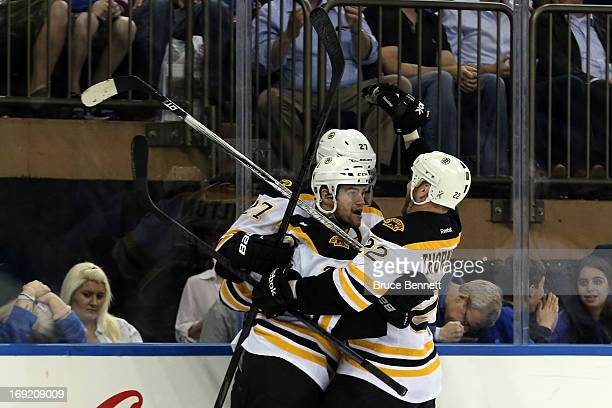 Daniel Paille of the Boston Bruins celebrates with teammates Dougie Hamilton and Shawn Thornton after scoring a goal in the third period to make the...