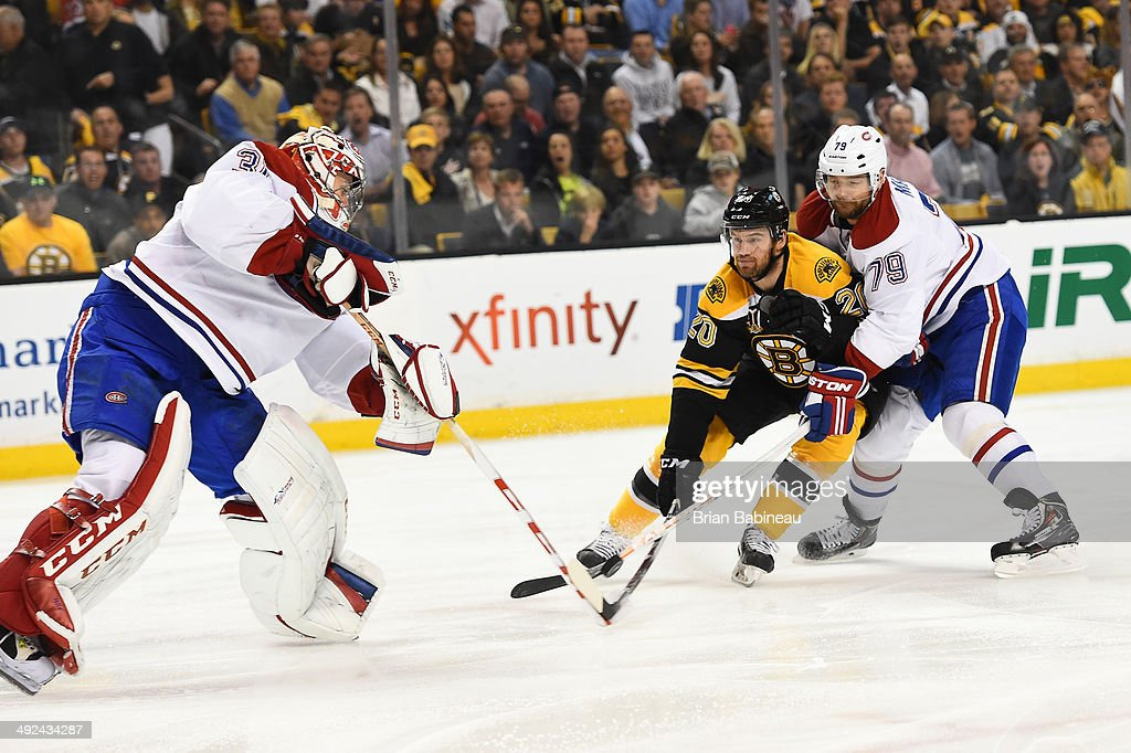 Daniel Paille #20 of the Boston Bruins fights for the puck against Carey Price #31 and Andrei Markov #79 of the Montreal Canadiens in Game Seven of the Second Round of the 2014 Stanley Cup Playoffs at TD Garden on May 14, 2014 in Boston, Massachusetts.