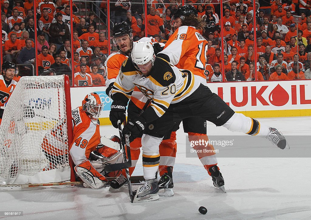Daniel Paille #20 of the Boston Bruins is knocked off the puck against the Philadelphia Flyers in Game Six of the Eastern Conference Semifinals during the 2010 NHL Stanley Cup Finals at the Wachovia Center on May 12, 2010 in Philadelphia, Pennsylvania. The Flyers defeated the Bruins 2-1.