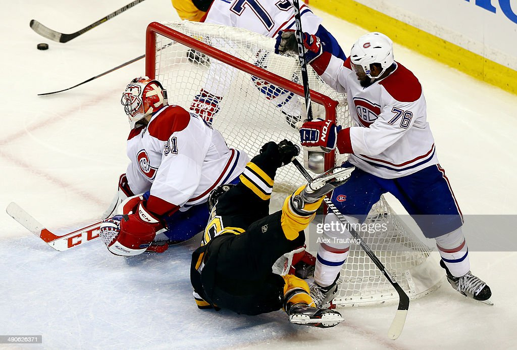 Daniel Paille #20 of the Boston Bruins is knocked to the ice by P.K. Subban #76 of the Montreal Canadiens during Game Seven of the Second Round of the 2014 NHL Stanley Cup Playoffs at the TD Garden on May 14, 2014 in Boston, Massachusetts.