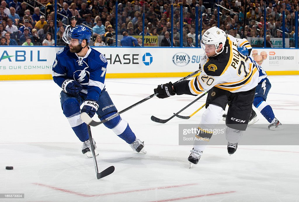 <a gi-track='captionPersonalityLinkClicked' href=/galleries/search?phrase=Daniel+Paille&family=editorial&specificpeople=706561 ng-click='$event.stopPropagation()'>Daniel Paille</a> #20 of the Boston Bruins shoots the puck by <a gi-track='captionPersonalityLinkClicked' href=/galleries/search?phrase=Radko+Gudas&family=editorial&specificpeople=5648763 ng-click='$event.stopPropagation()'>Radko Gudas</a> #7 of the Tampa Bay Lightning during the second period at the Tampa Bay Times Forum on October 19, 2013 in Tampa, Florida.