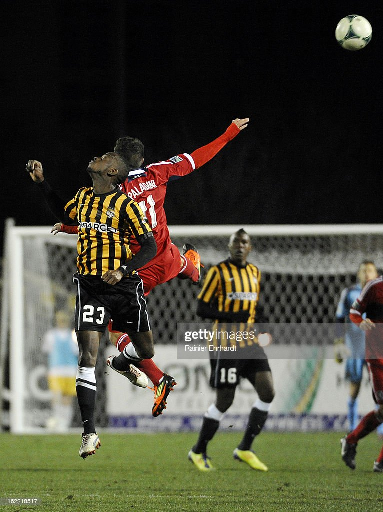 Daniel Paladini #11 of the Chicago Fire and Amadou Sanyang #23 of the Charleston Battery jump for a header during the second half of a game at Blackbaud Stadium on February 20, 2013 in Charleston, North Carolina.
