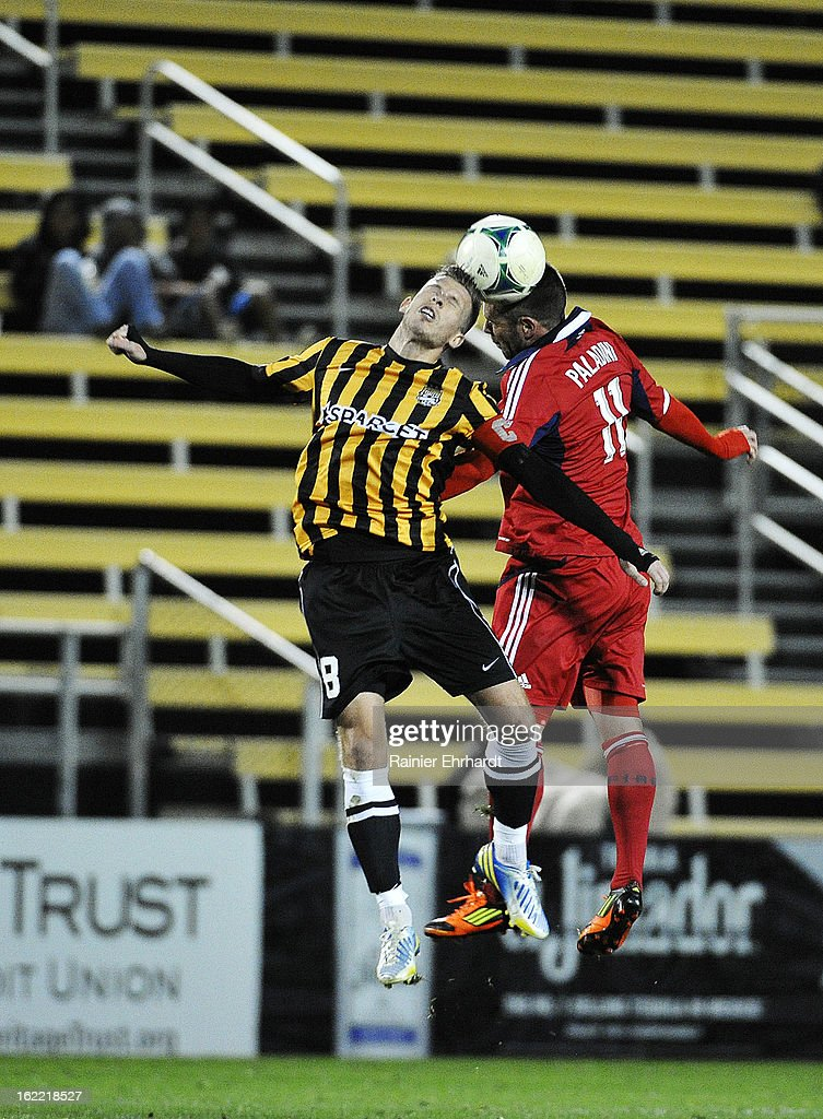 Daniel Paladini #11 of the Chicago Fire and Nicki Paterson #8 of the Charleston Battery jump for a header during the second half of a game at Blackbaud Stadium on February 20, 2013 in Charleston, North Carolina.