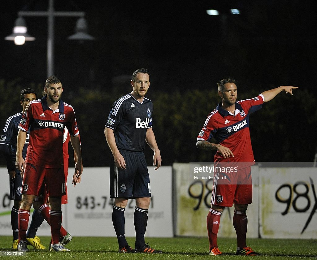 Daniel Paladini #11 of the Chicago Fire points during a free kick as teammate Steven Kinney #18 and Andy O'Brien #40 of the Vancouver Whitecaps FC look on during the second half of a game at Blackbaud Stadium on February 23, 2013 in Charleston, South Carolina.