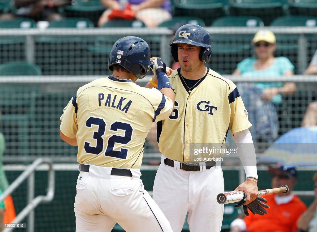 Daniel Palka #32 is congratulated by Brandon Thomas #6 of the Georgia Tech Yellow Jackets after he hit a two run home run against the Miami Hurricanes on May 18, 2013 at Alex Rodriguez Park at Mark Light Field in Coral Gables, Florida. Georgia Tech defeated Miami 10-1.
