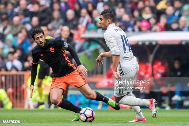 Daniel Parejo Munoz of Valencia CF competes for the ball with Carlos Henrique Casemiro of Real Madrid during their La Liga match between Real Madrid...