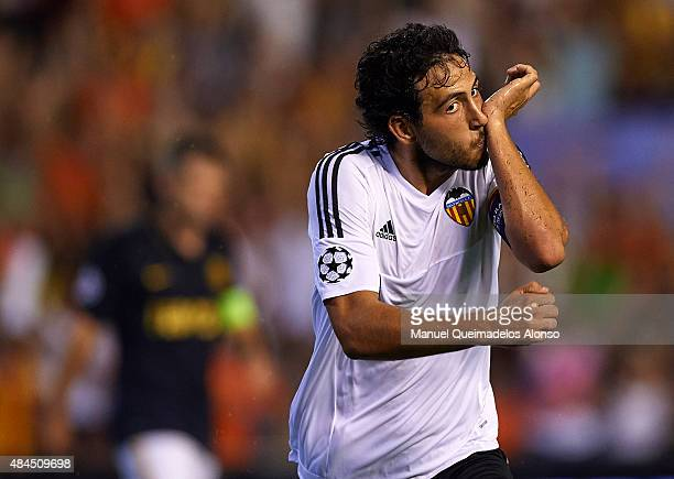 Daniel Parejo of Valencia celebrates scoring his team's second goal during the UEFA Champions League Qualifying Round Play Off First Leg match...