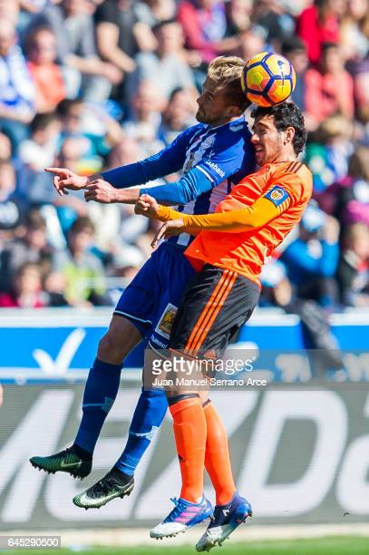 Daniel Parejo of Valencia CF duels for the ball with Theo Hernandez of Deportivo Alaves during the La Liga match between Deportivo Alaves and...