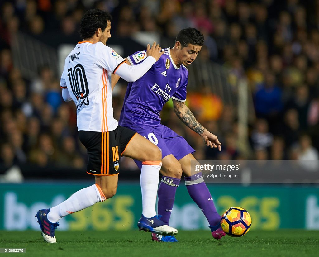 Daniel Parejo (L) of Valencia competes for the ball with James Rodriguez of Real Madrid during the La Liga match between Valencia CF and Real Madrid at Mestalla Stadium on February 22, 2017 in Valencia, Spain.