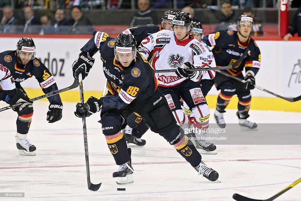 Daniel Pietta (C) of Germany in action during the Olympic Icehockey Qualifier match between Germany and Austria on February 10, 2013 in Bietigheim-Bissingen, Germany.