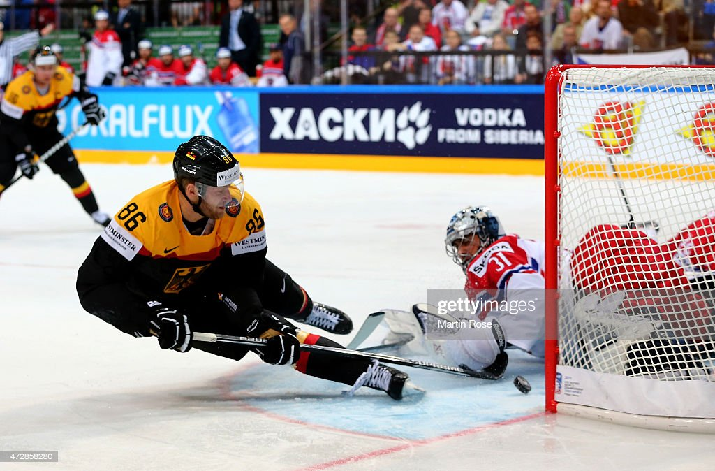 Daniel Pietta (L) of Germany scores his team's opening goal over Ondrej Pavelec (R), goaltender of Czech Republic during the IIHF World Championship group A match between Germany and Czech Repubic at o2 Arena on May 10, 2015 in Prague, Czech Republic.