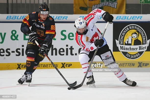 Daniel Pietta of Germany skates against Dominik Schlumpf of Switzerland during match 2 of the Deutschland Cup 2014 between Germany and Switzerland at...
