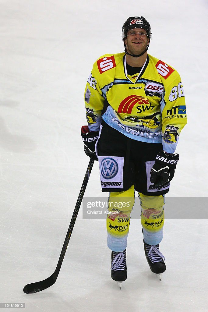 Daniel Pietta of Krefeld Pinguine looks dejected during the fifth DEL Play-Off-match between Krefeld Pinguine and ERC Ingolstadt at Koenigspalast on March 28, 2013 in Wuppertal, Germany.