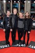 Daniel Platzman Dan Reynolds Ben McKee and Wayne Sermon of Imagine Dragons arrive at the 2014 MuchMusic Video Awards at MuchMusic HQ on June 15 2014...