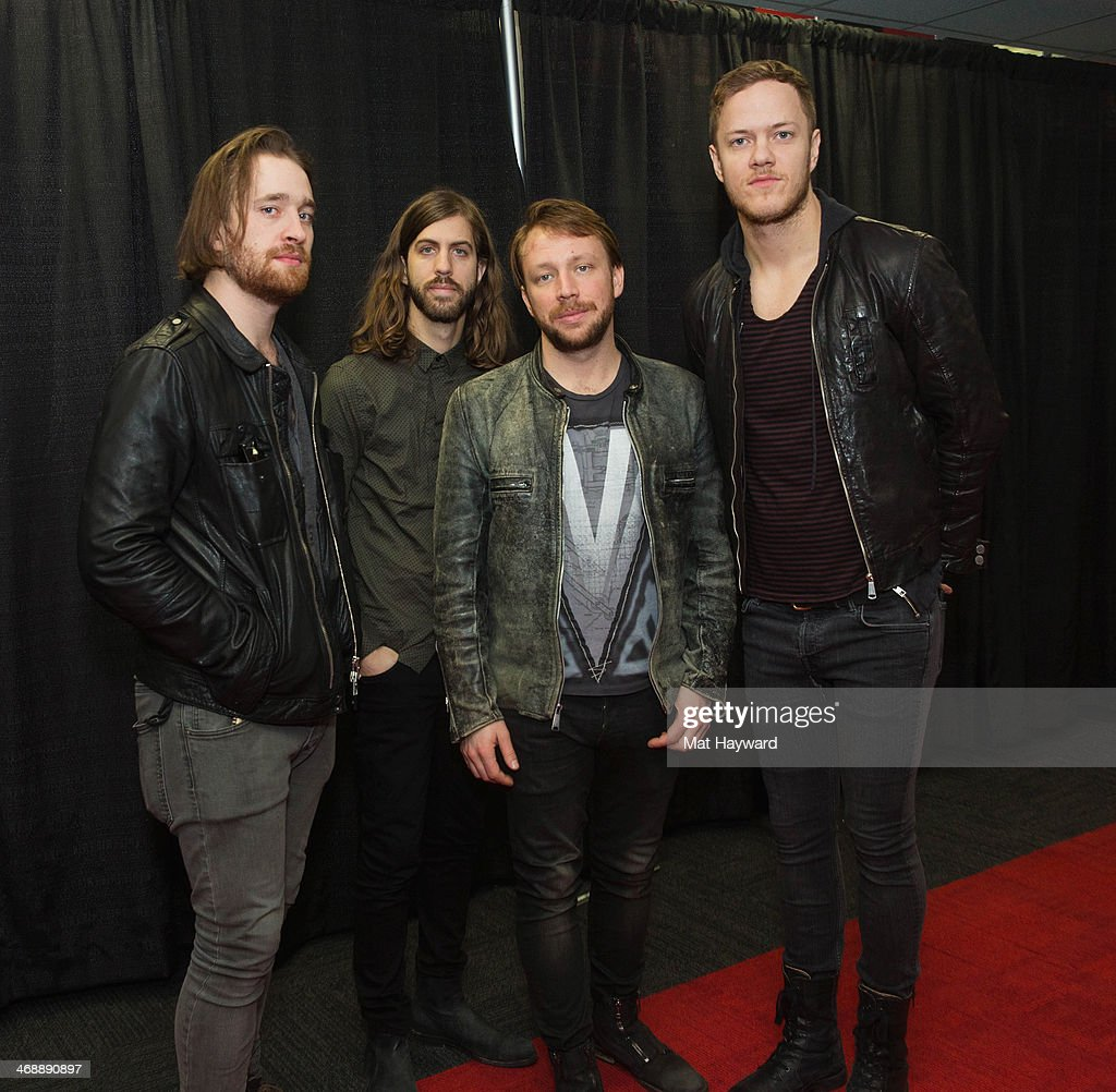 Daniel Platzman, Wayne Sermon, <a gi-track='captionPersonalityLinkClicked' href=/galleries/search?phrase=Ben+McKee&family=editorial&specificpeople=8995201 ng-click='$event.stopPropagation()'>Ben McKee</a> and <a gi-track='captionPersonalityLinkClicked' href=/galleries/search?phrase=Dan+Reynolds&family=editorial&specificpeople=8995077 ng-click='$event.stopPropagation()'>Dan Reynolds</a> of Imagine Dragons pose for a photo backstage at KeyArena on February 11, 2014 in Seattle, Washington.
