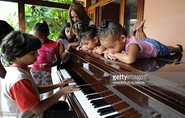 Daniel plays the piano for his mother Flordelis dos Santos and some of her 50 sons four of them her own and another 46 adoptedat their home in...
