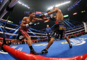 Daniel Ponce de Leon exchanges blows with Abner Mares in their WBC featherweight title bout at the MGM Grand Garden Arena on May 4 2013 in Las Vegas...