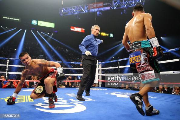 Daniel Ponce de Leon is knocked down in the second round by Abner Mares in their WBC featherweight title bout at the MGM Grand Garden Arena on May 4...