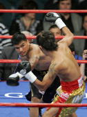 Daniel Ponce De Leon knocks back Sod Looknongyangtoy with a left during the WBO junior featherweight world championship fight at the MGM Grand Garden...