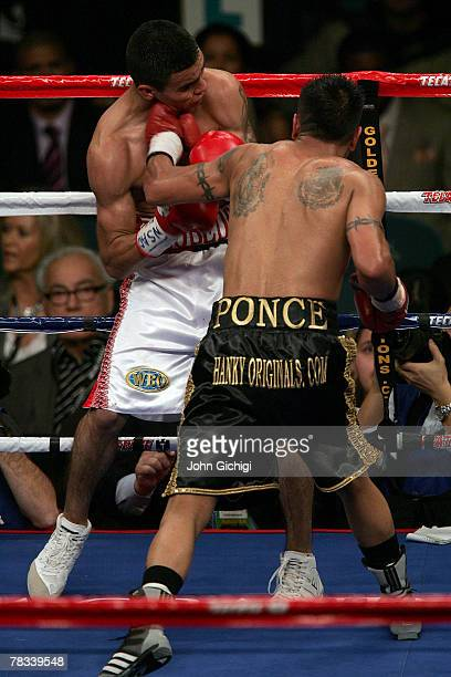 Daniel Ponce De Leon of Mexico knocks back Eduardo Escobedo of Mexico with a left during their junior featherweight fight at the MGM Grand Garden...