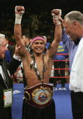 Daniel Ponce De Leon raises his arms after knocking out Sod Looknongyangtoy 52 seconds into the first round of their WBO junior featherweight world...