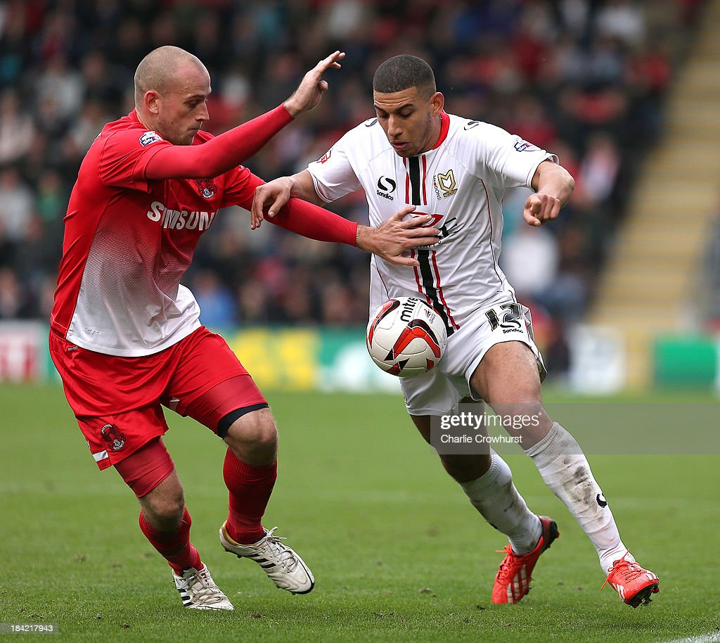 Daniel Powell of MK Dons looks to get past Scott Cuthbert of Orient during the Sky Bet League One match between Leyton Orient and MK Dons at The Matchroom Stadium on October 12, 2013 in London, England.