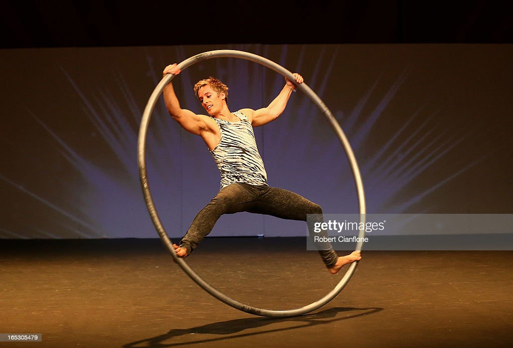 Daniel Price performs with the Roue Cyr during a National Institute of Circus Arts photo call for 'Leap of Faith: Circus in Motion' at NICA on April 3, 2013 in Melbourne, Australia.