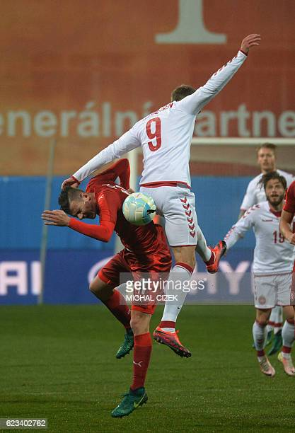 Daniel Pudil of Czech Republic vies for a ball with Nicolai Jorgensen of Denmark during the friendly football match Czech Republic vs Denmark in...