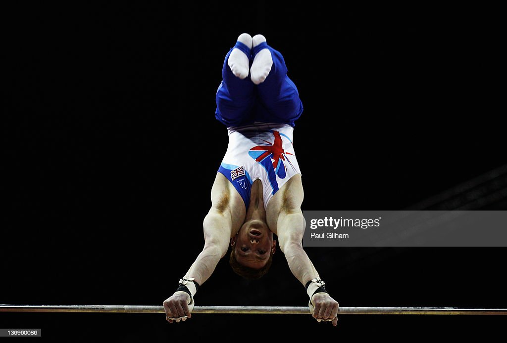 Daniel Purvis of Great Britain in action on the horizontal bar during the Gymnastics Trampoline Olympic Qualification round at North Greenwich Arena on January 13, 2012 in London, England.
