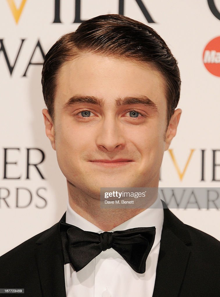Daniel Radcliffe poses in the press room at The Laurence Olivier Awards 2013 at The Royal Opera House on April 28, 2013 in London, England.