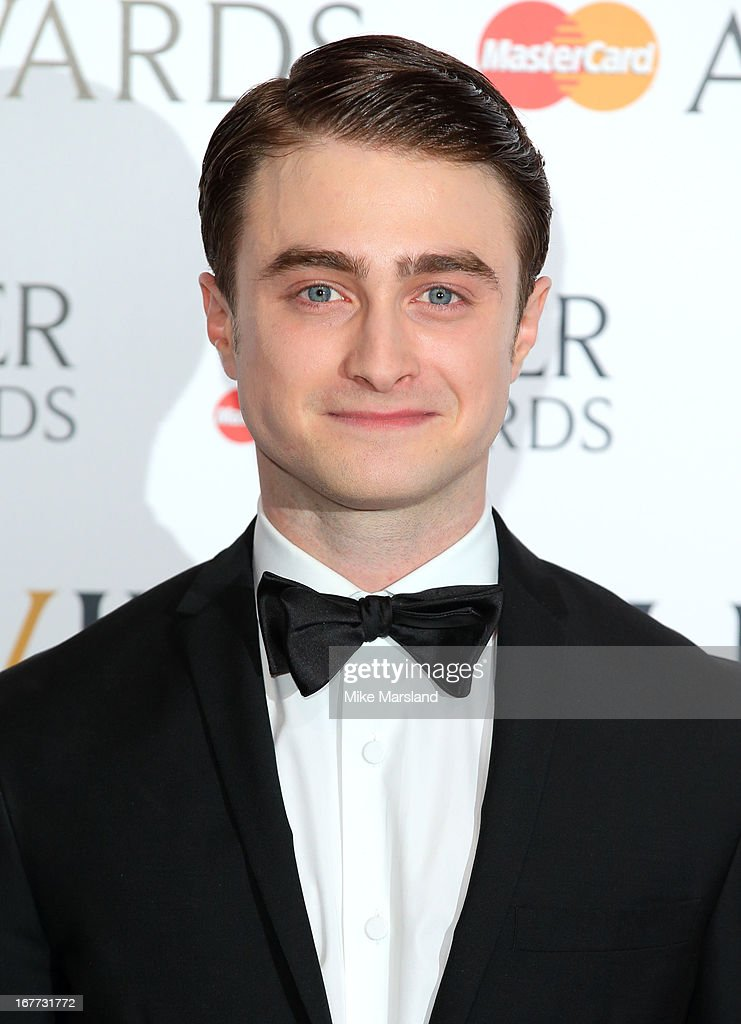 Daniel Radcliffe poses in the press room at The Laurence Olivier Awards at The Royal Opera House on April 28, 2013 in London, England.