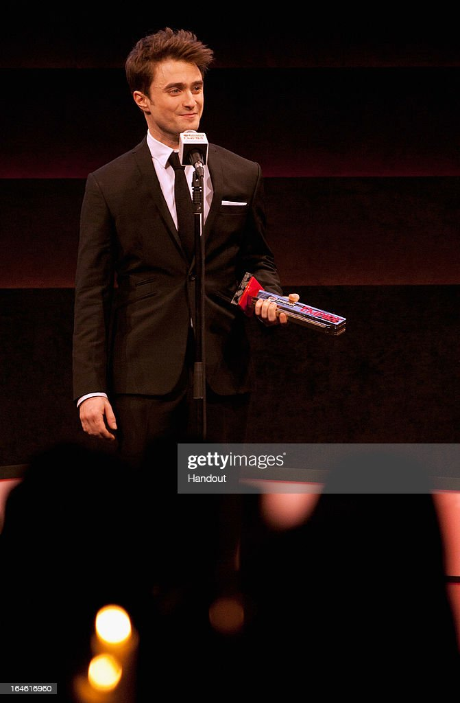 <a gi-track='captionPersonalityLinkClicked' href=/galleries/search?phrase=Daniel+Radcliffe&family=editorial&specificpeople=204144 ng-click='$event.stopPropagation()'>Daniel Radcliffe</a> wins the Empire Hero award at the Jameson Empire Awards at Grosvenor House on March 24, 2013 in London, England. Renowned for being one of the most laid-back awards shows in the British movie calendar, the Jameson Empire Awards celebrate the film industry's success stories of the year with Empire Magazine readers voting for the winners. Visit empireonline.com/awards2013 for more information.