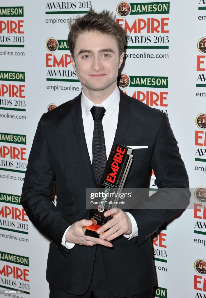 Daniel Radcliffe with the Empire Hero award at the Jameson Empire Awards 2013 at Grosvenor House on March 24, 2013 in London, England.