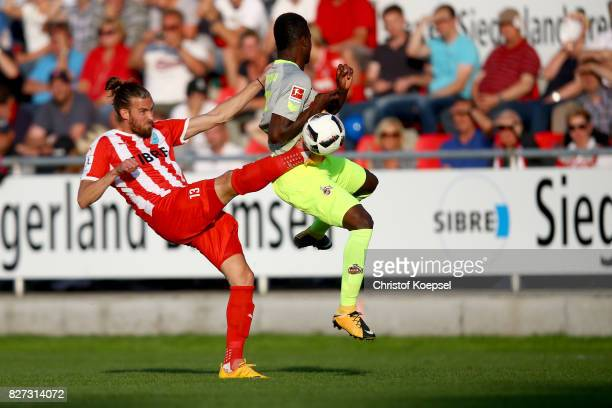Daniel Reith of Steinbsch challenges Jhon Cordoba of Koeln during the preseason friendly match between TSV Steinbach and 1 FC Koeln at...