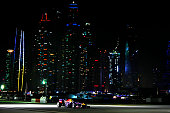 Daniel Ricciardo and Sebastian Vettel drive during an Infiniti Red Bull Racing show run in Dubai ahead of the Abu Dhabi Formula One Grand Prix at Yas...