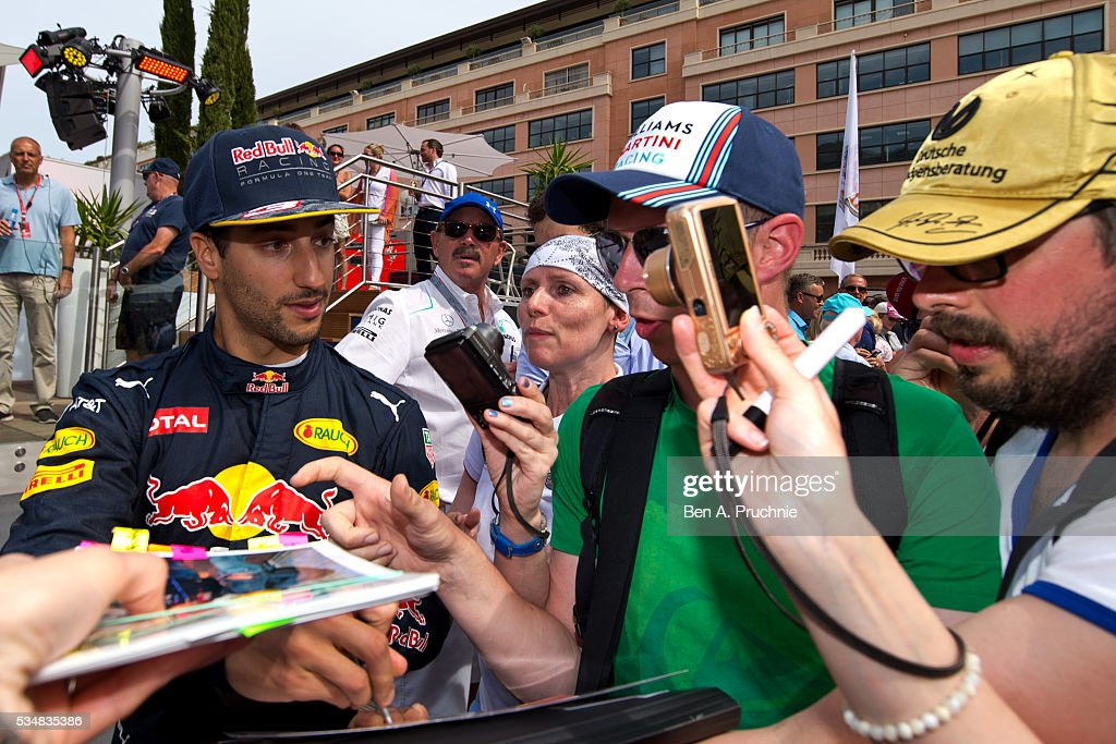 <a gi-track='captionPersonalityLinkClicked' href=/galleries/search?phrase=Daniel+Ricciardo&family=editorial&specificpeople=6547569 ng-click='$event.stopPropagation()'>Daniel Ricciardo</a> is signs autographs for fans as he arrives on the deck of the Red Bull Racing Energy Station at Monte Carlo on May 28, 2016 in Monaco, Monaco.