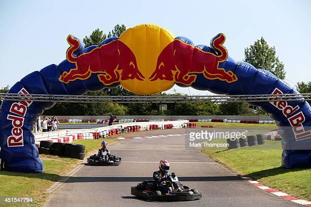 Daniel Ricciardo of Australia and Infiniti Red Bull Racing and Sebastien Buemi competes during the Red Bull Open House Go Karting at Daytona...