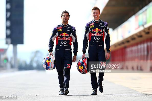 Daniel Ricciardo of Australia and Infiniti Red Bull Racing and Daniil Kvyat of Russia and Infiniti Red Bull Racing walk along the pit lane during day...