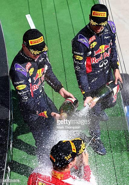 Daniel Ricciardo of Australia and Infiniti Red Bull Racing and Daniil Kvyat of Russia and Infiniti Red Bull Racing celebrate on the podium with race...
