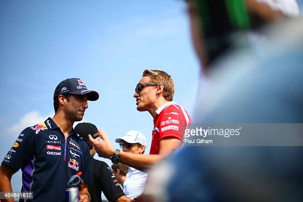 Daniel Ricciardo of Australia and Infiniti Red Bull Racing and Max Chilton of Great Britain and Marussia take part in the Drivers Parade prior to the...