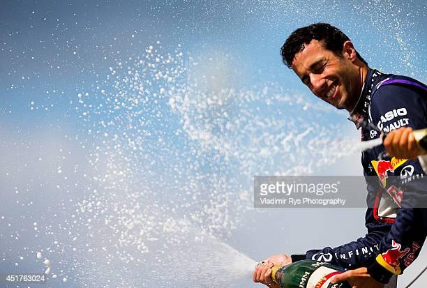 Daniel Ricciardo of Australia and Infiniti Red Bull Racing celebrates on the podium after finishing third during the British Formula One Grand Prix...