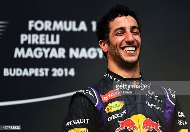 Daniel Ricciardo of Australia and Infiniti Red Bull Racing celebrates victory on the podium after the Hungarian Formula One Grand Prix at Hungaroring...